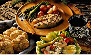 background image of delicious seafood plate with a salad and bread